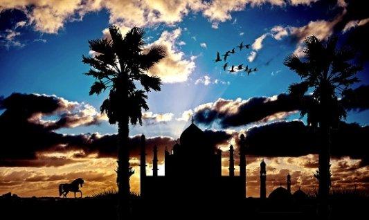 Paisaje oriental con palacio, mezquita y palmeras.